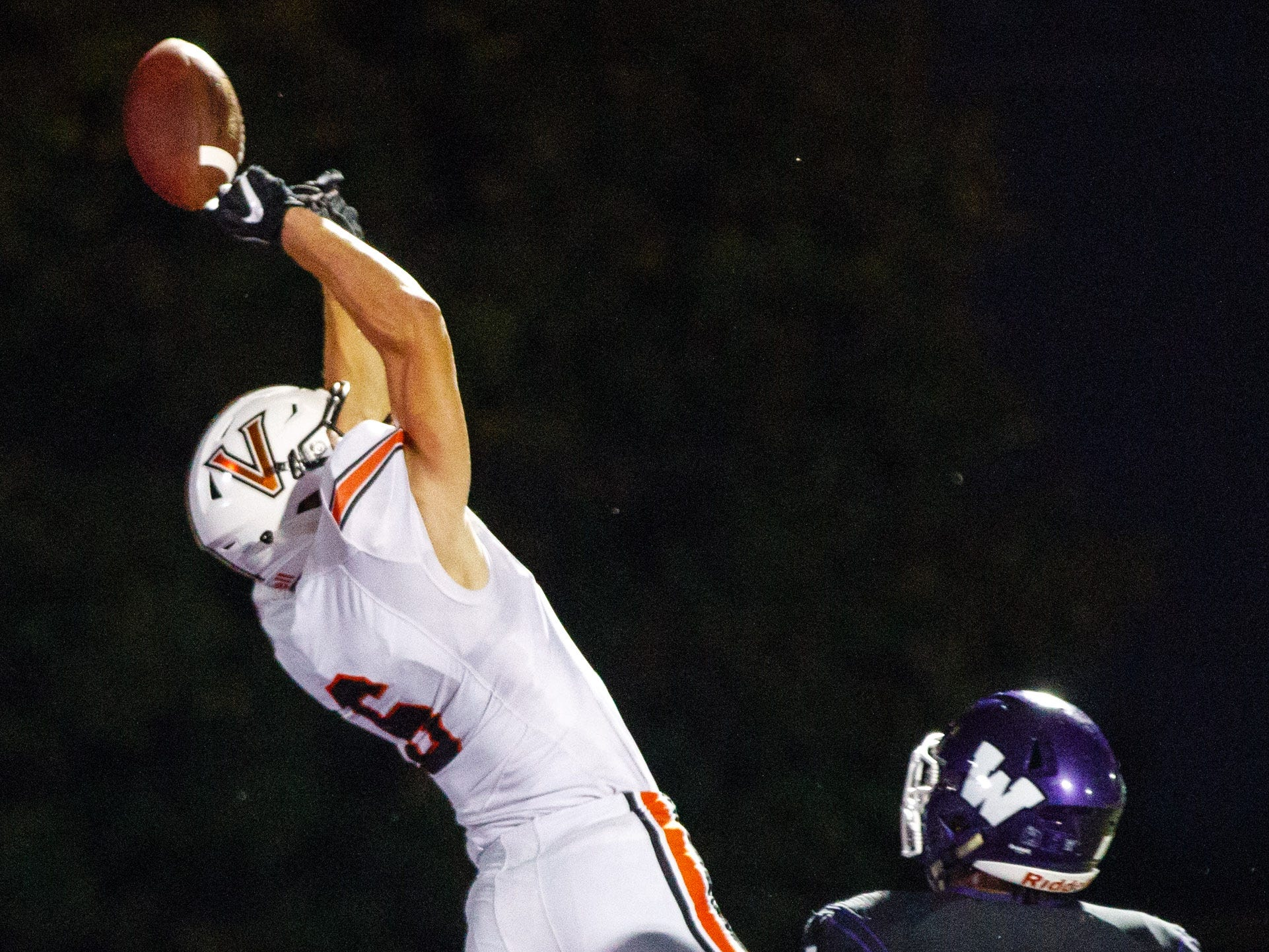 Valley High School's Parker Marschel (6) tries to pull in a pass in the end zone over Waukee's Aaron Smith (5) in the second quarter Friday, Sept. 14, 2018, at Waukee Stadium.