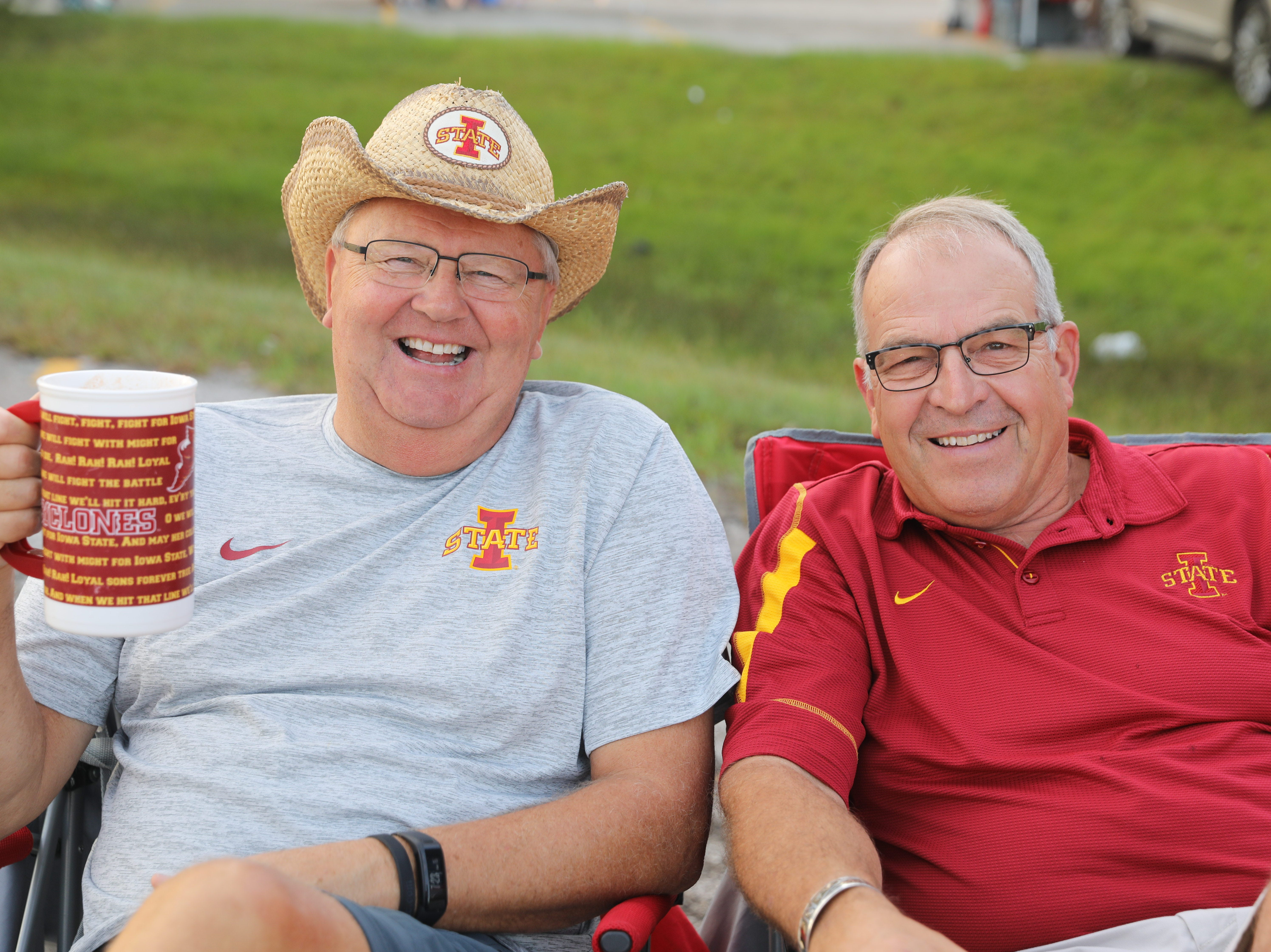 Jim Sogard of Ames (left) and Steve Perry of New Providence Saturday, Sept. 15, 2018, before the Iowa State football game against Oklahoma in Ames.