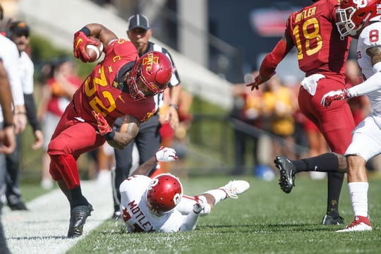 Iowa State's David Montgomery (32) is pushed out of bounds by Oklahoma's Parnell Motley (11) during their football game at Jack Trice Stadium on Saturday, Sept. 15, 2018 in Ames. Oklahoma takes a 24-10 lead into halftime.