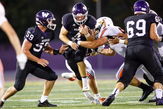 Waukee High School's Mitch Randall (4) runs the ball on Valley in the second quarter Friday, Sept. 14, 2018, at Waukee Stadium.