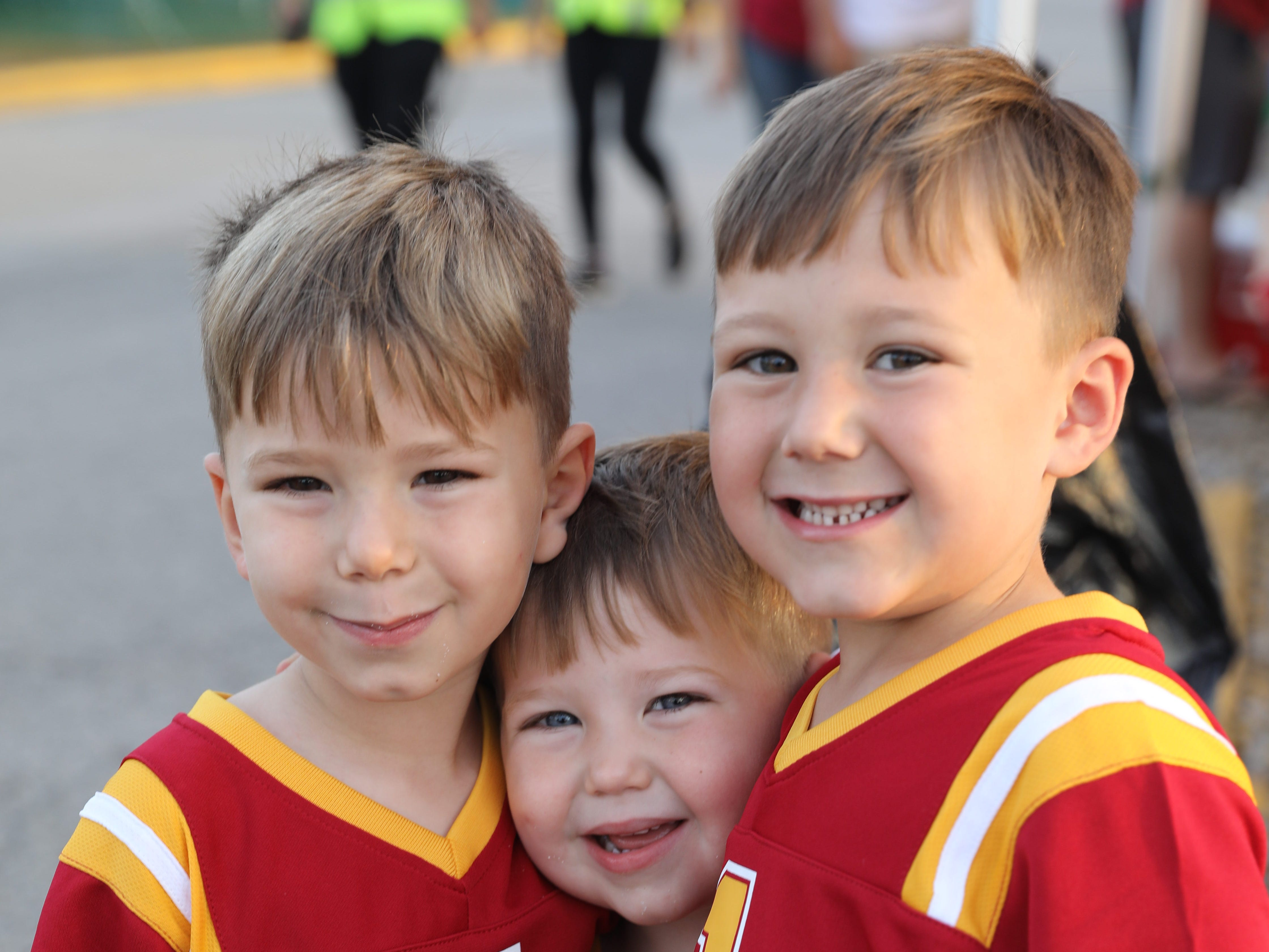 Colin Christensen, 4, (from left) Carter Christensen, 2, and Clayton Christensen, 5, all of St. Louis Saturday, Sept. 15, 2018, before the Iowa State football game against Oklahoma in Ames.