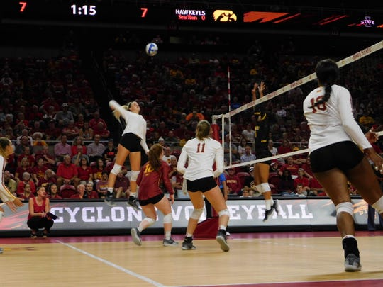 Iowa State's Jess Schaben (left) attacks in Iowa's 3-1 win over the Cyclones Friday at Ames.