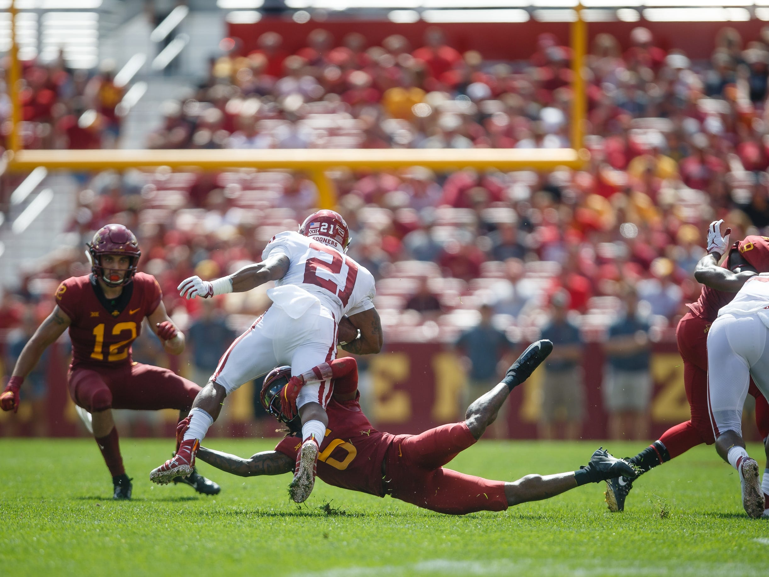 Oklahoma's Marcelias Sutton (21) tries to run over Iowa State's De'Monte Ruth (6) during their football game at Jack Trice Stadium on Saturday, Sept. 15, 2018 in Ames. Oklahoma would go on to win 37-27.