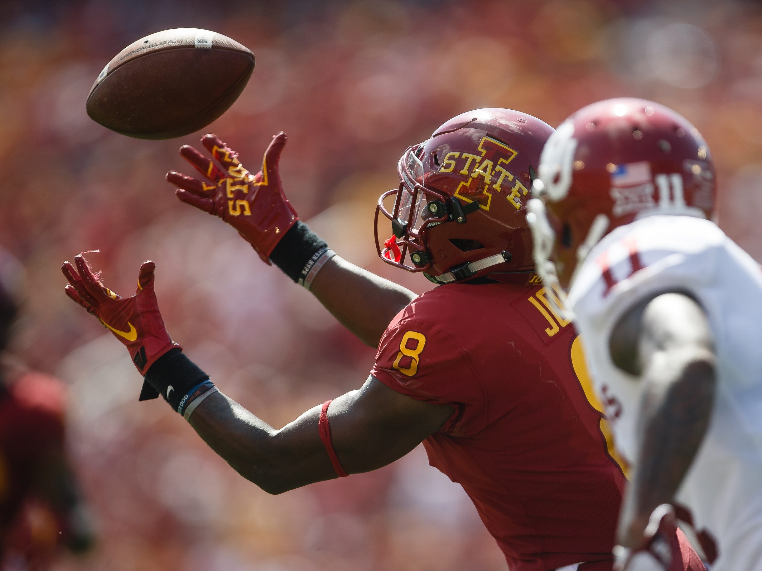 Iowa State's Deshaunte Jones (8) bobbles a pass during their football game at Jack Trice Stadium against Oklahoma on Saturday, Sept. 15, 2018 in Ames. Oklahoma would go on to win 37-27.