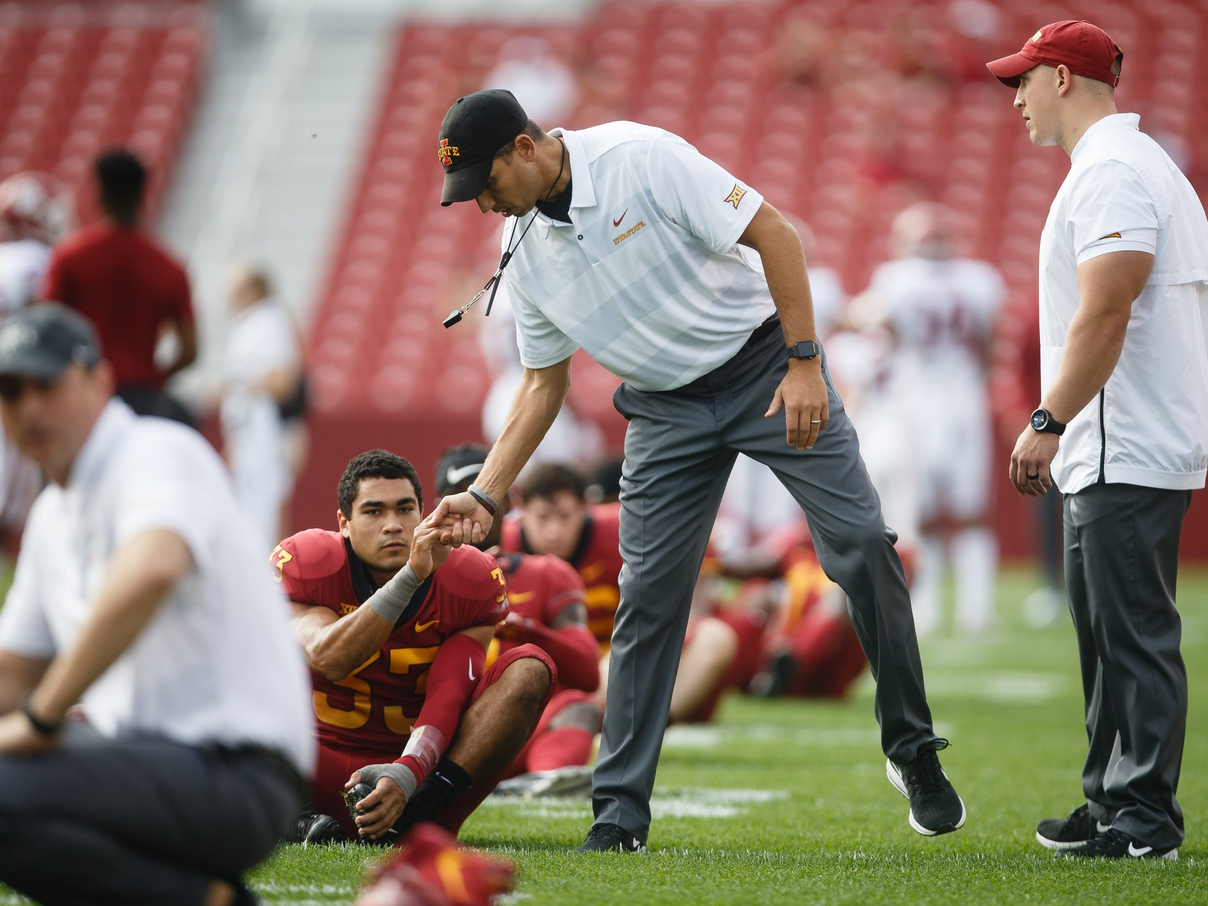 Iowa State head coach Matt Campbell walks around as his players warm up before their football game against Oklahoma at Jack Trice Stadium on Saturday, Sept. 15, 2018 in Ames. Oklahoma would go on to win 37-27.