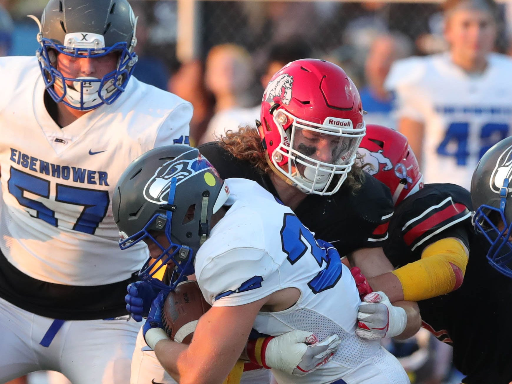 Romeo RB/LB Brock Horne makes the tackle against Eisenhower's Caleb Oyster during the first half Friday, Sept. 14, 2018.