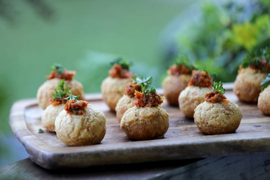 Parmesan Gougeres with salt cod brandade  an d tomato confit relish is served at the Apparatus Room booth, during the 2018 Detroit Free Press Wine & Food Experience at Campus Martius park in downtown Detroit on Saturday, Sept. 15, 2018.