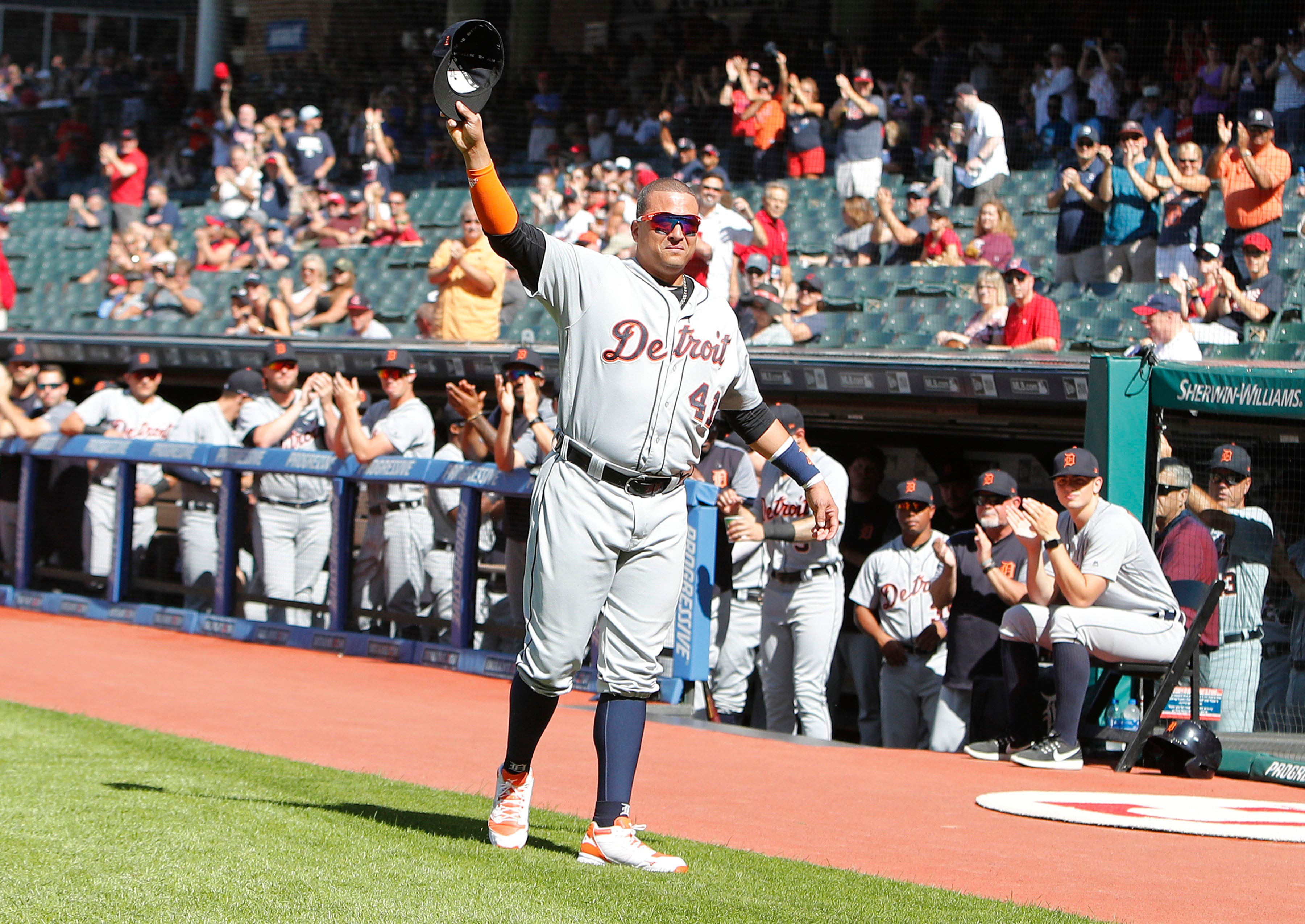 Tigers designated hitter Victor Martinez waves to the Indians crowd after receiving a plaque honoring his announced retirement during a pre-game ceremony before the start of the Tigers' 15-0 loss on Saturday, Sept. 15, 2018, in Cleveland.