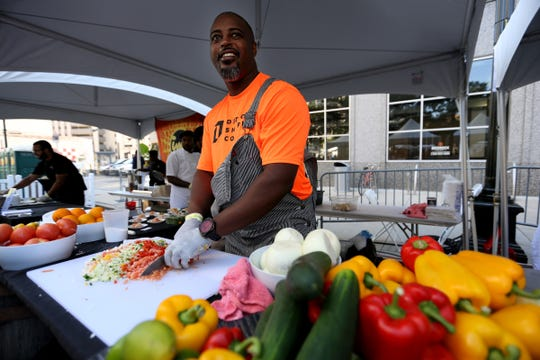 Chef Max Hardy prepares conch salad, during the 2018 Detroit Free Press Wine & Food Experience at Campus Martius park in downtown Detroit on Saturday, Sept. 15, 2018.