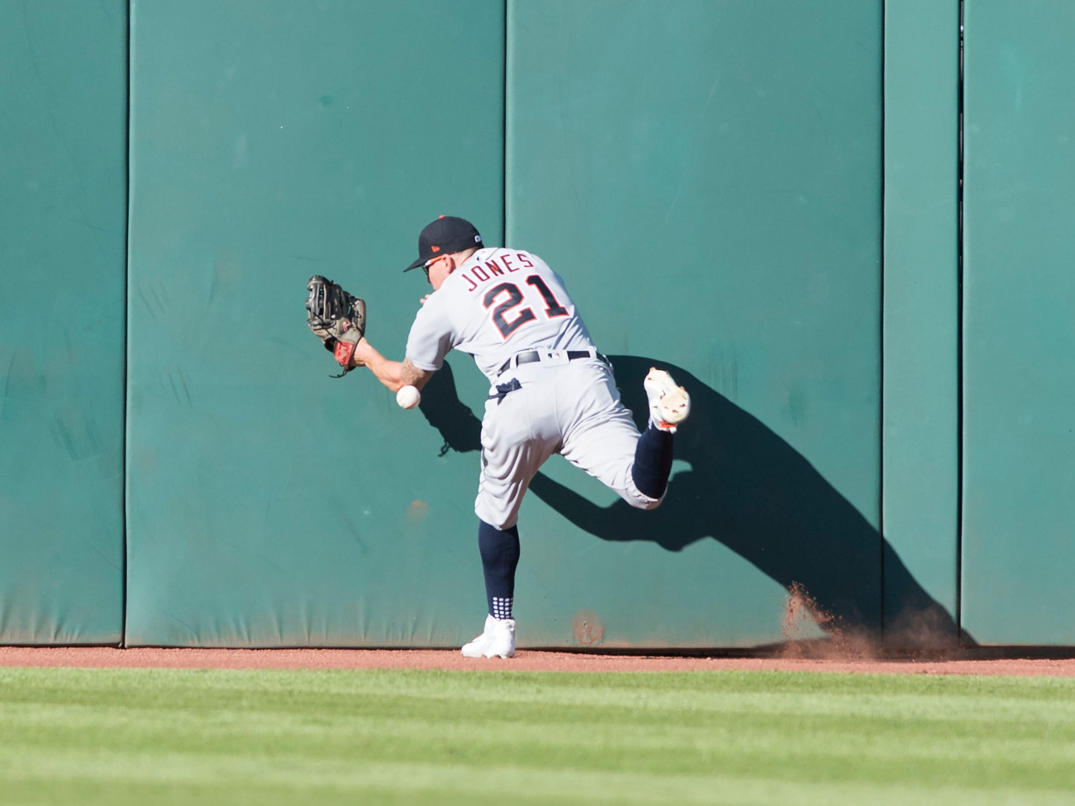 JaCoby Jones can not make the catch in center field on a triple hit by the Indians during the fourth inning of the Tigers' 15-0 loss Saturday, Sept. 15, 2018, in Cleveland.