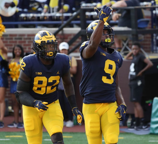 Michigan's Nick Eubanks, left, and Donovan Peoples-Jones celebrate after a touchdown against SMU during the first half Saturday, Sept. 15, 2018, at Michigan Stadium.