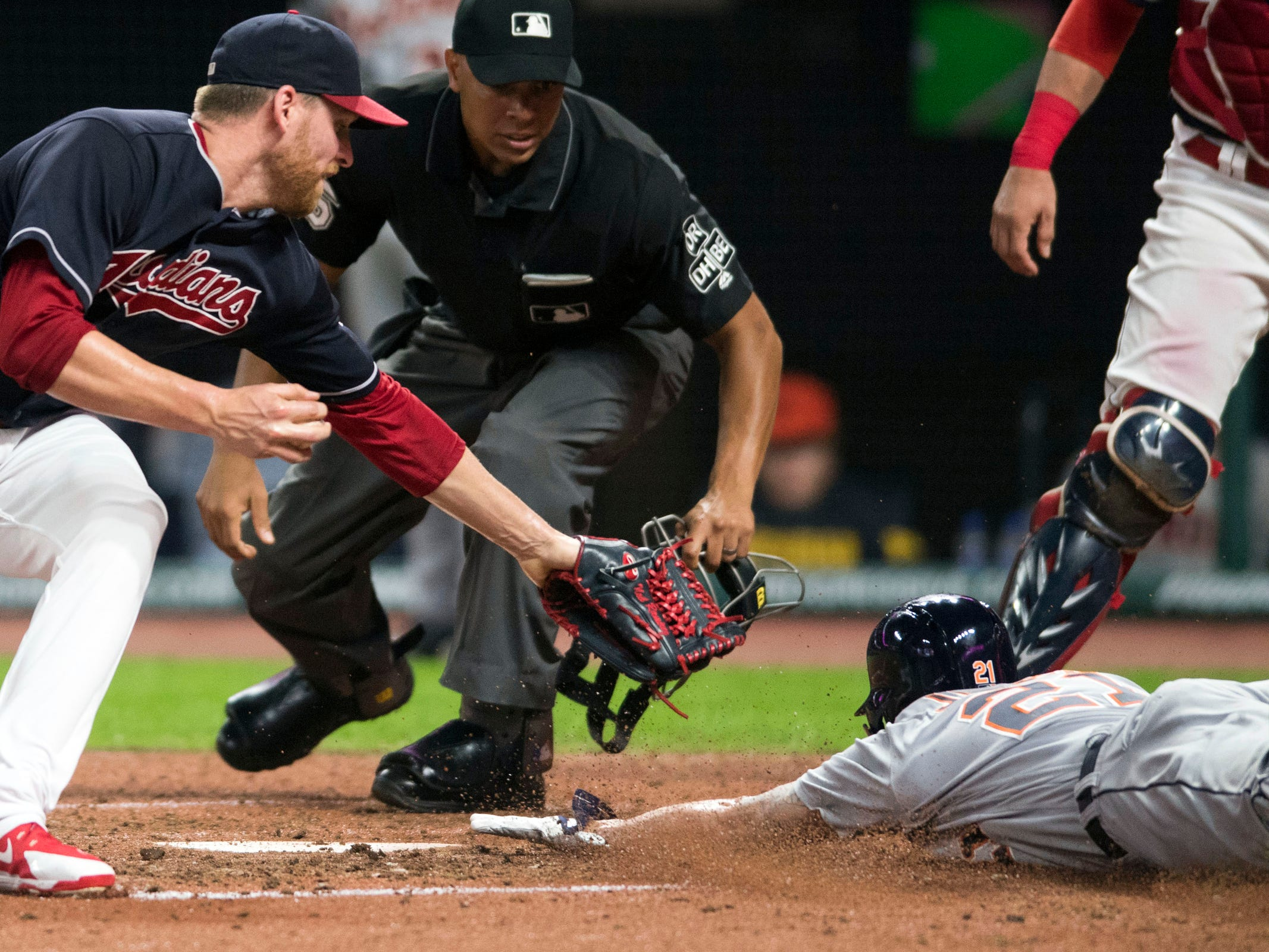 Detroit Tigers center fielder JaCoby Jones scores on a wild pitch as Cleveland Indians reliever Neil Ramirez covers the plate during the eighth inning at Progressive Field, Friday, Sept. 14, 2018, in Cleveland.