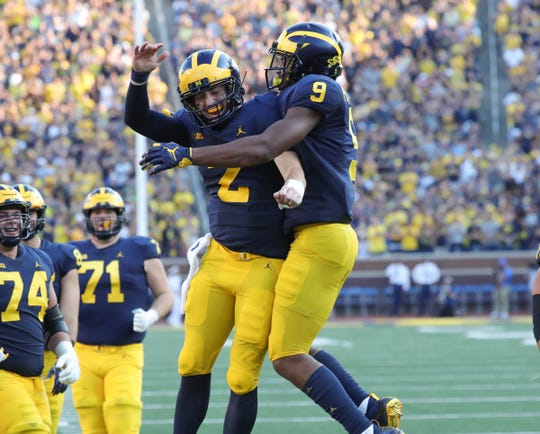 Michigan quarterback Shea Patterson, left, and receiver Donovan Peoples-Jones celebrate their touchdown connection against SMU during the second half Saturday, Sept. 15, 2018 at Michigan Stadium in Ann Arbor.