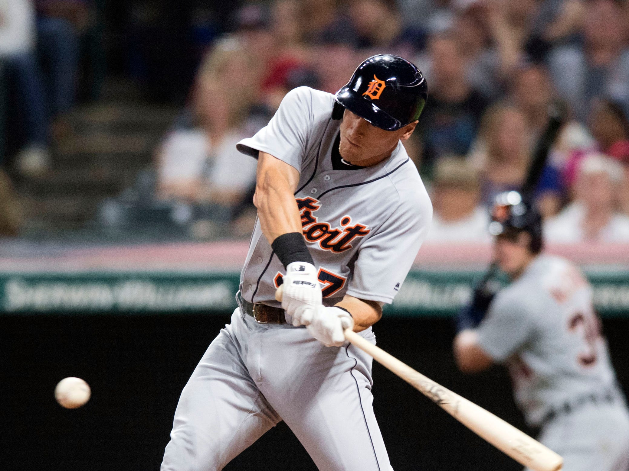 Detroit Tigers first baseman Jim Adduci hits a double during the fourth inning against the Cleveland Indians at Progressive Field, Friday, Sept. 14, 2018, in Cleveland.