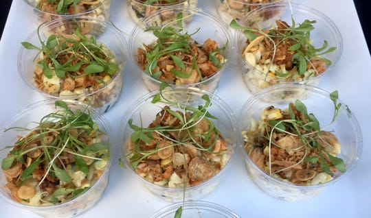 Wright & Co., shared its charred corn salad with blackened shrimp, cilantro dressing topped with crispy shallots at the Detroit Free Press Wine & Food Experience on Sept. 15, 2018.