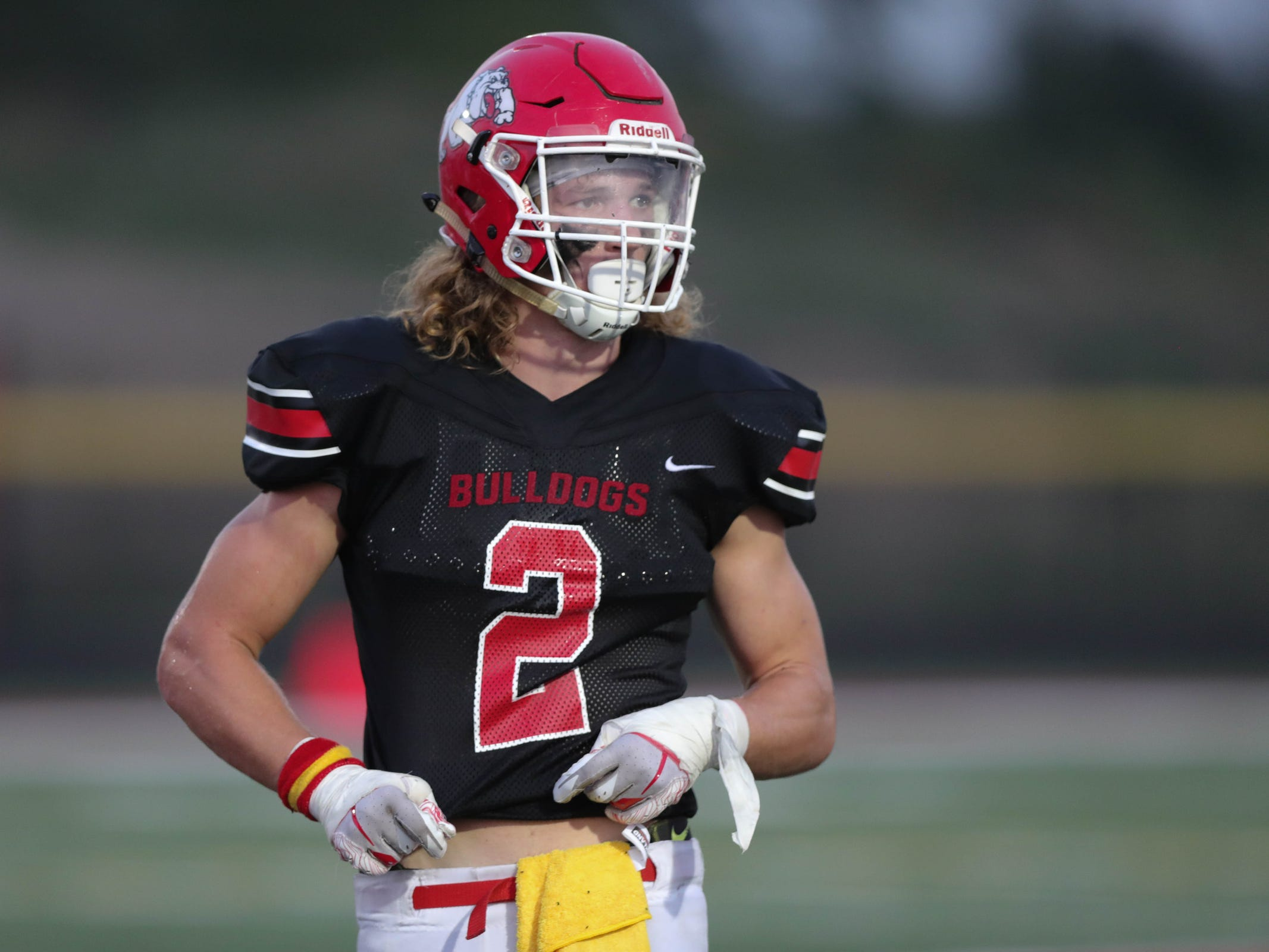 Romeo RB/LB Brock Horne lines up during the first half against Eisenhower, Friday, Sept. 14, 2018.
