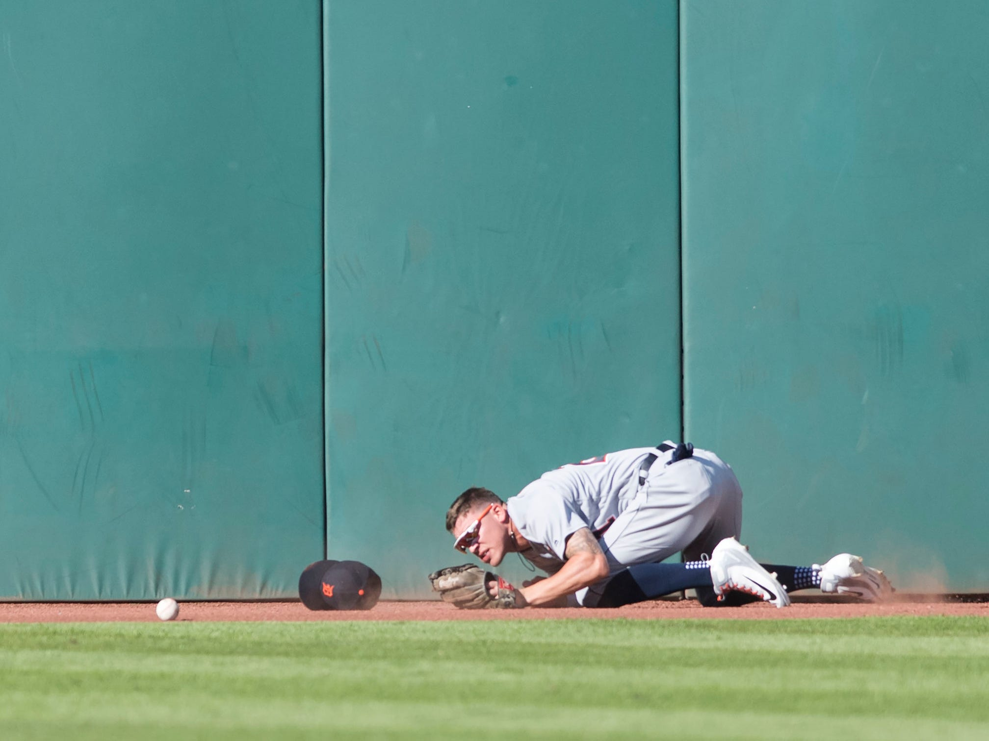 Tigers center fielder JaCoby Jones lies on the ground after missing the ball that went for an RBI triple hit by Indians second baseman Jose Ramirez (not pictured) during the fourth inning of the Tigers' 15-0 loss on Saturday, Sept. 15, 2018, in Cleveland.