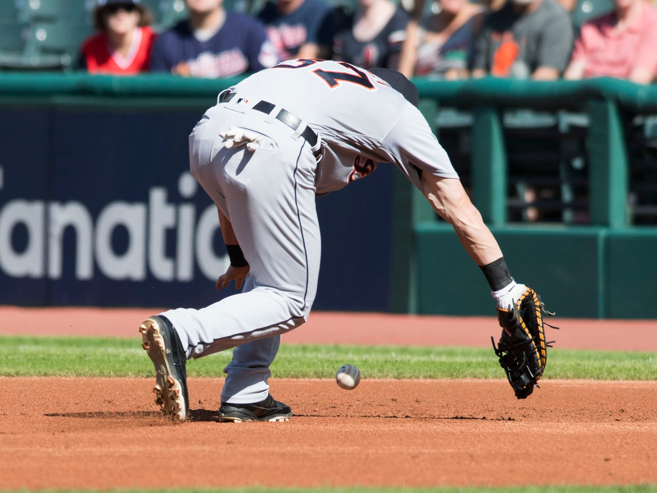 Sep 15, 2018; Cleveland, OH, USA; Detroit Tigers first baseman Jim Adduci (37) makes an error on a hit by Cleveland Indians designated hitter Edwin Encarnacion (not pictured) during the first inning at Progressive Field. Mandatory Credit: Ken Blaze-USA TODAY Sports