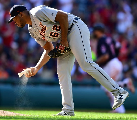 Tigers pitcher Sandy Baez waits for Indians first baseman Yonder Alonso to run the bases after hitting a two-run home run in the third inning of the Tigers' 15-0 loss on Saturday, Sept. 15, 2018, in Cleveland.