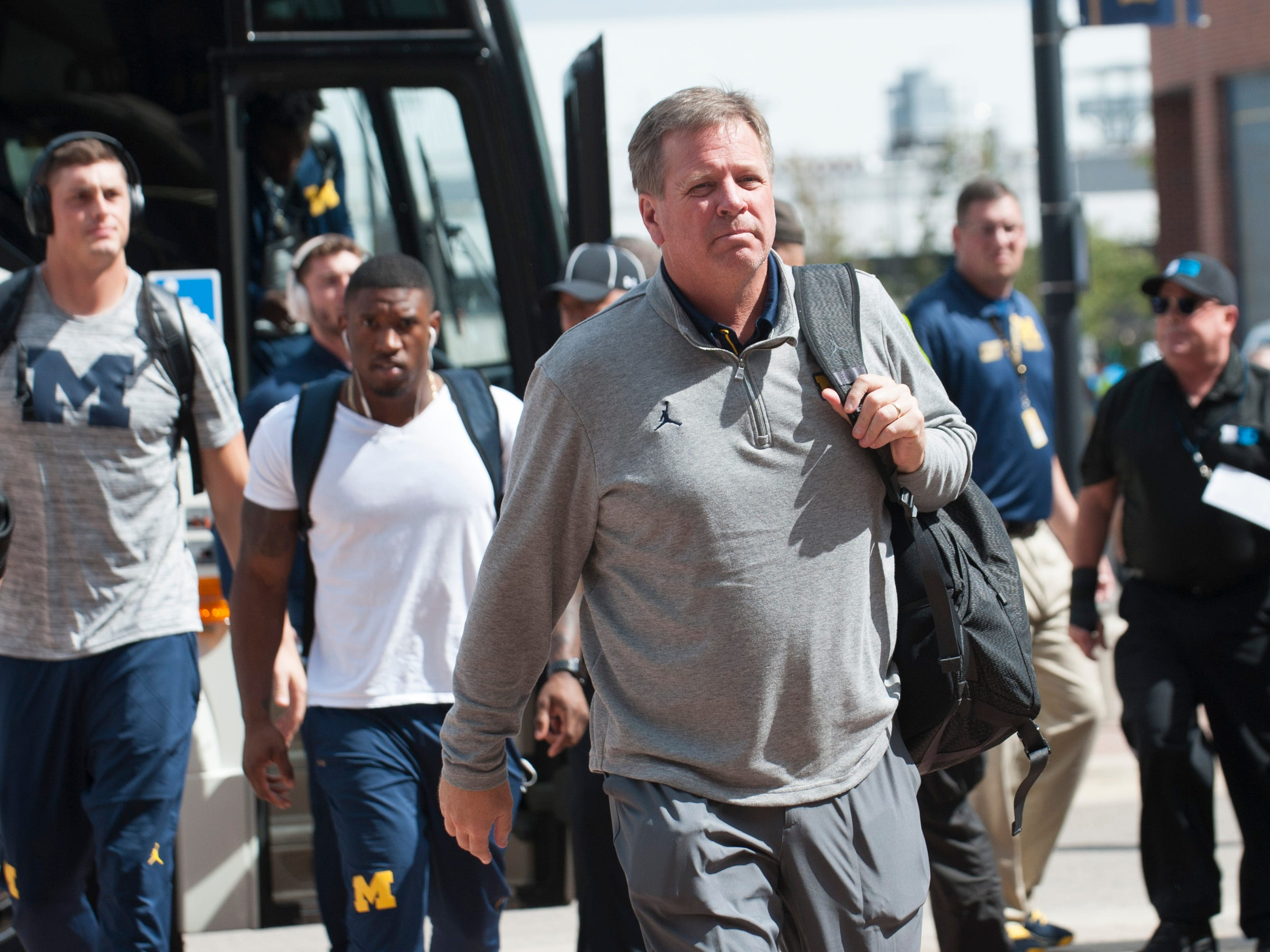 Michigan wide receivers coach Jim McElwain  arrives at Michigan Stadium in Ann Arbor before the game.