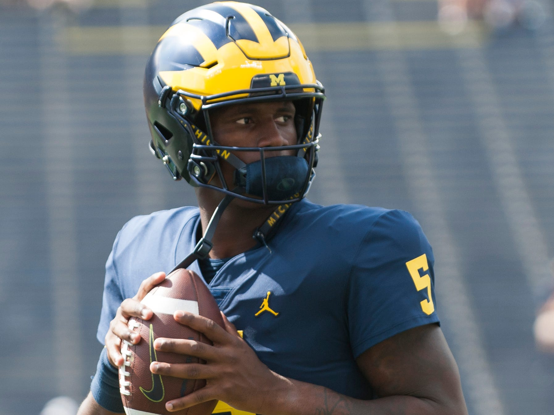 Michigan freshman quarterback Joe Milton warms up before the game.