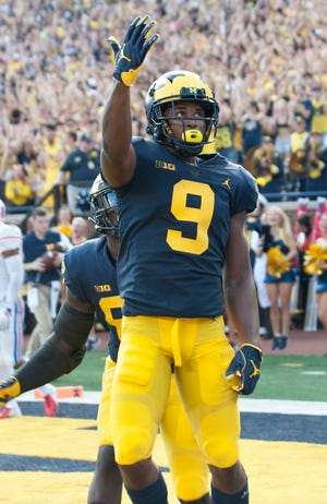 Michigan wide receiver Donovan Peoples-Jones acknowledges the crowd after scoring on a 35-yard touchdown pass from quarterback Shea Patterson in the second quarter.