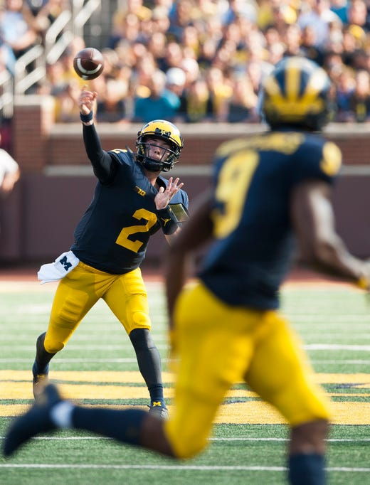 Michigan quarterback Shea Patterson throws a strike to wide receiver Donovan Peoples-Jones who takes it 35 yards for a touchdown in the second quarter.