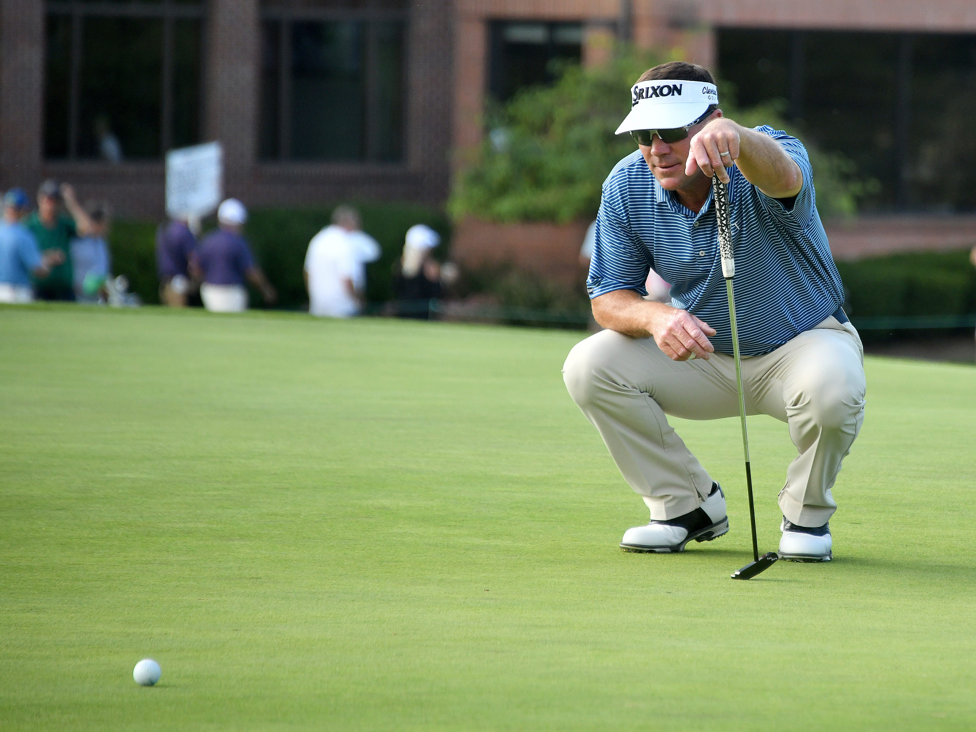 Leader Brandt Jobe looks over the ninth green before putting on day one.
