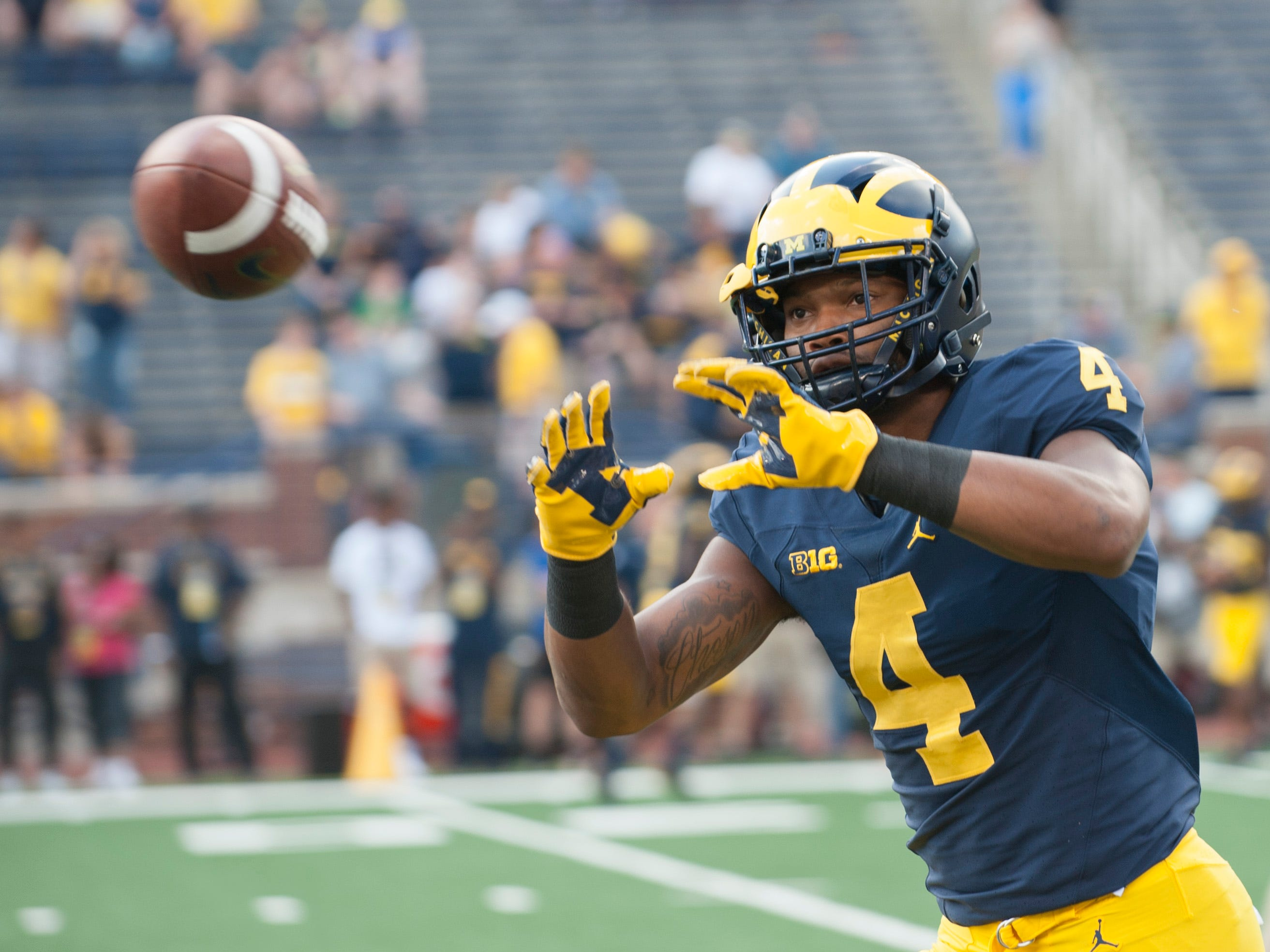 Michigan wide receiver Nico Collins catches a pass during pre-game warmups.