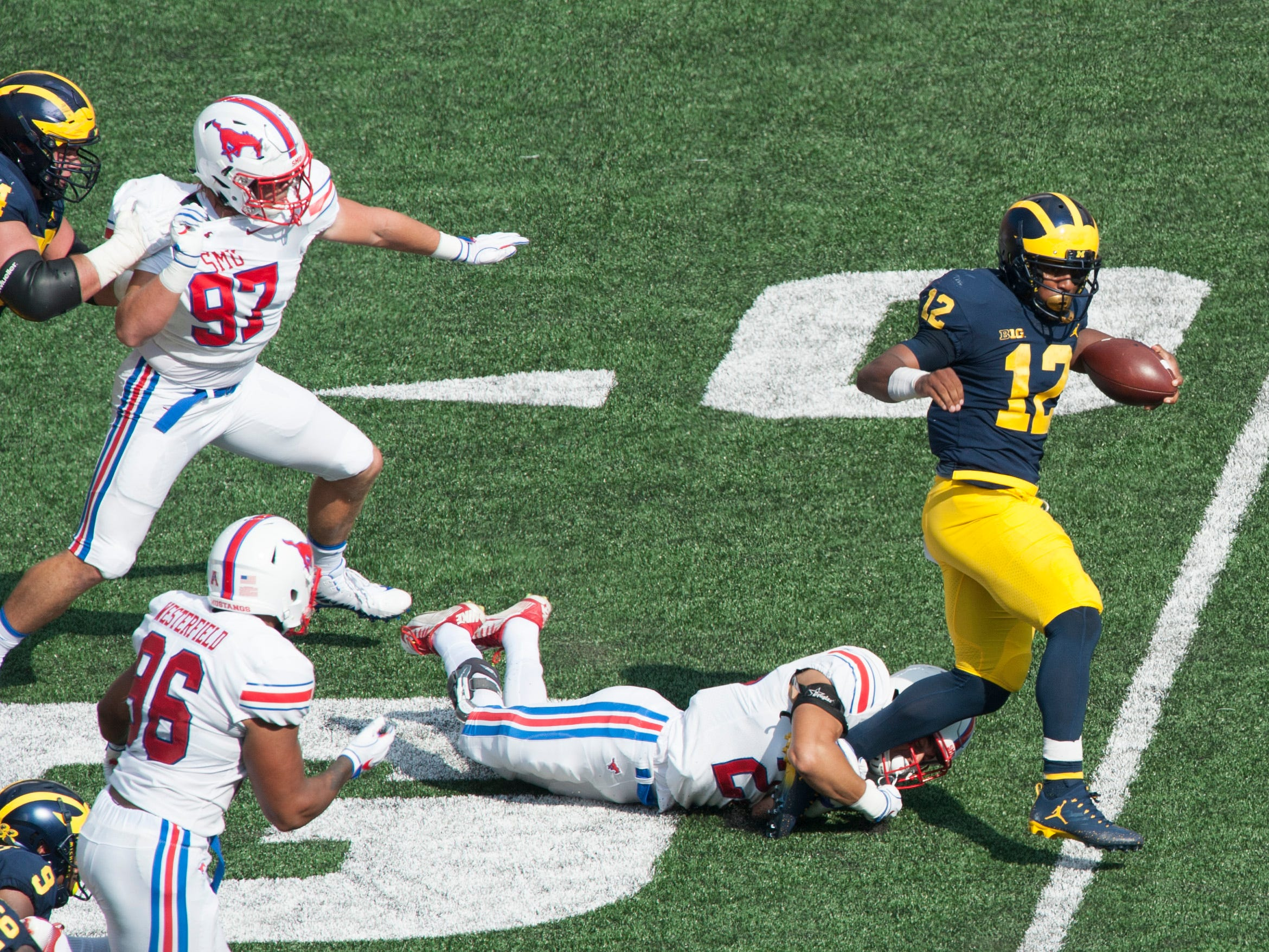 Michigan running back Chris Evans gains some yardage in the first quarter.