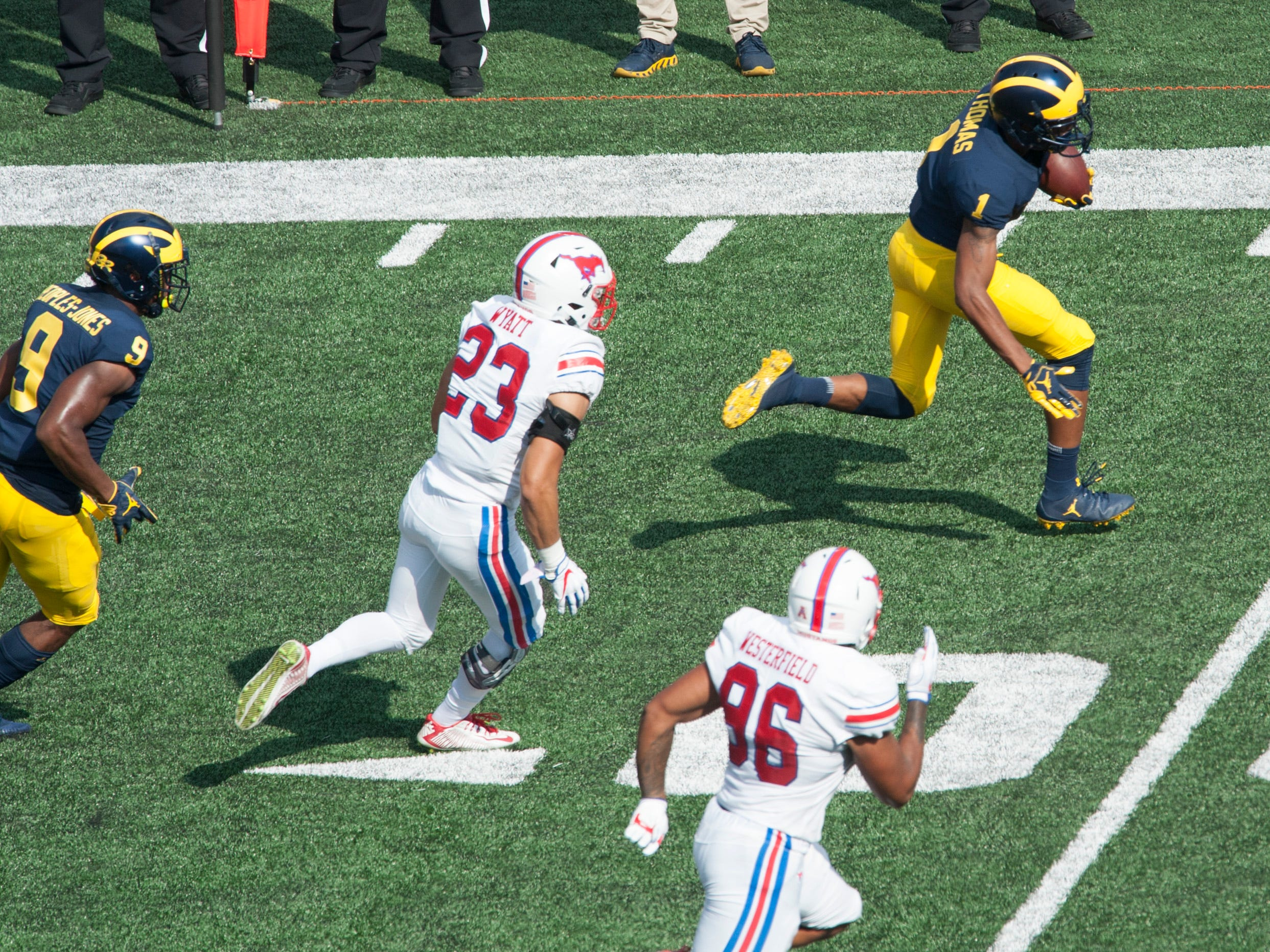 Michigan's  Ambry Thomas runs for a first down on a sweep play in the first quarter.