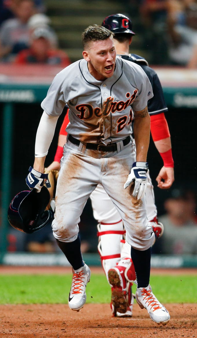 Detroit Tigers' JaCoby Jones reacts after scoring on a wild pitch by Cleveland Indians' Neil Ramirez during the eighth inning.