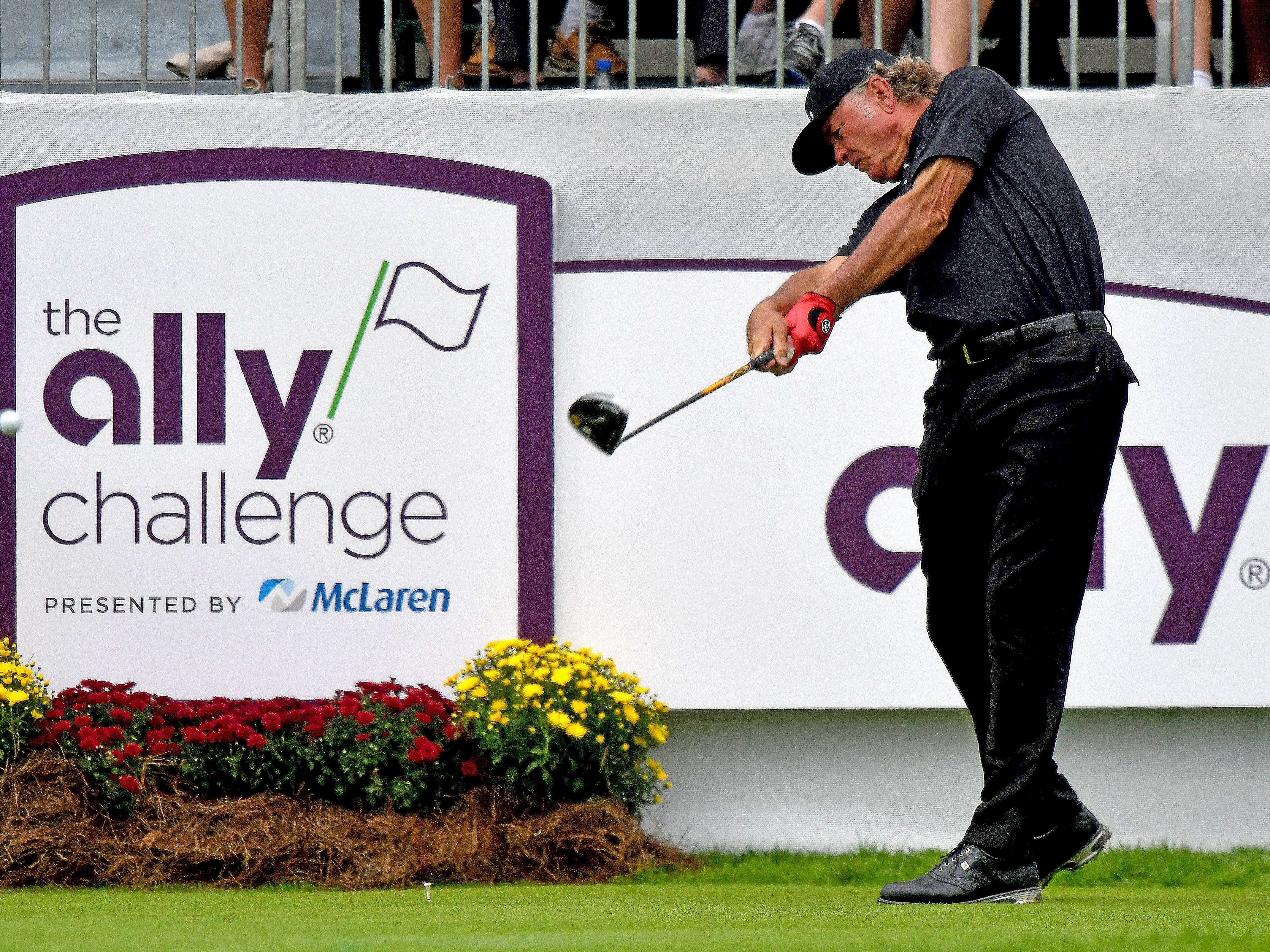 Tommy Armor III hits the ball off the first tee on day one of the Ally Challenge.