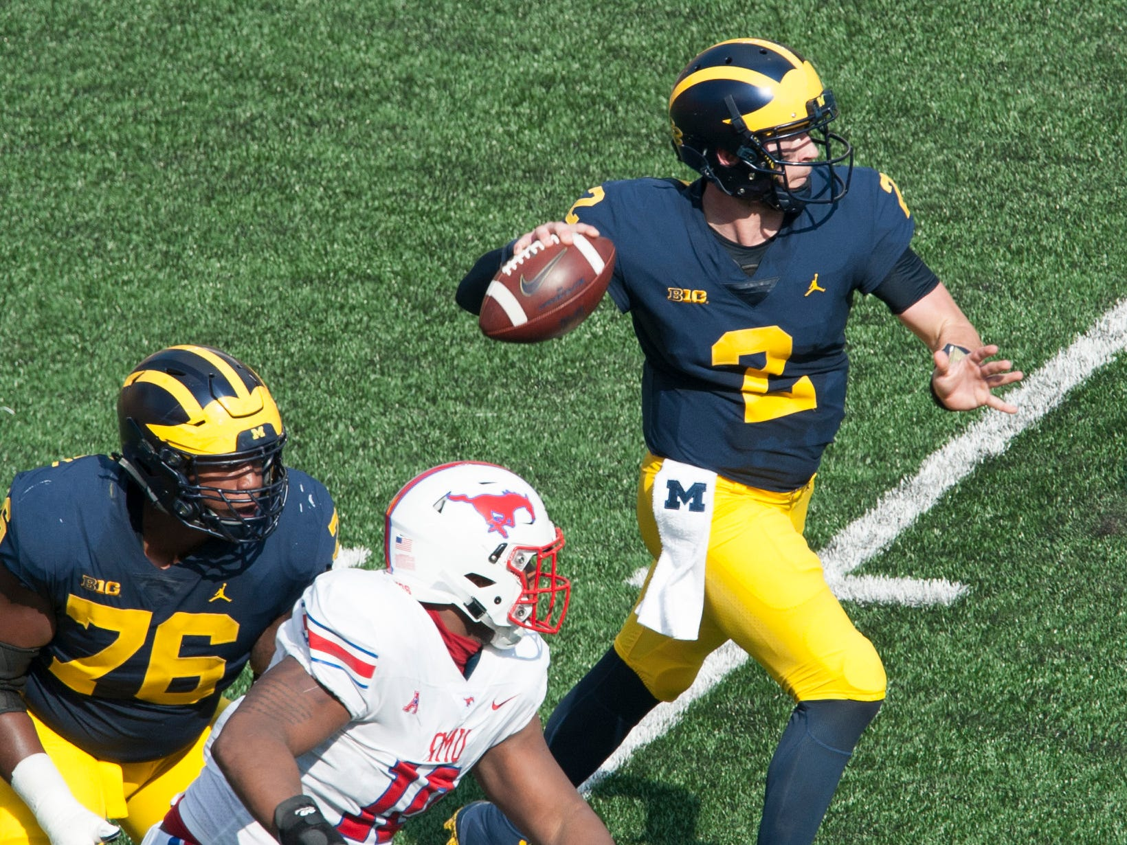 Michigan quarterback Shea Patterson rolls out to throw in the first quarter.