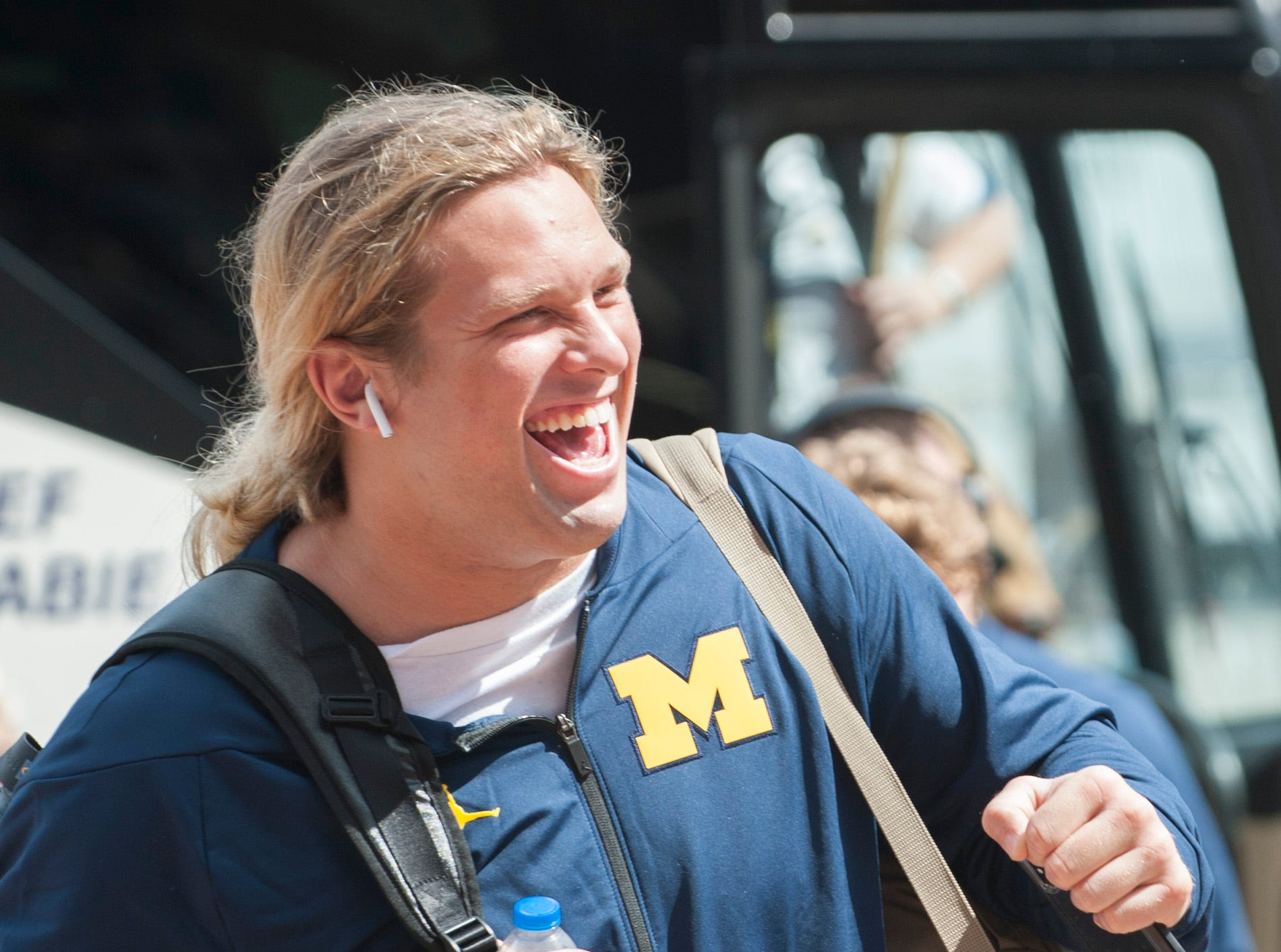 Michigan defensive lineman Chase Winovich arrives at Michigan Stadium in a jovial mood before the Wolverines's game against Southern Methodist University (SMU) in Ann Arbor on Saturday, September 15, 2018.