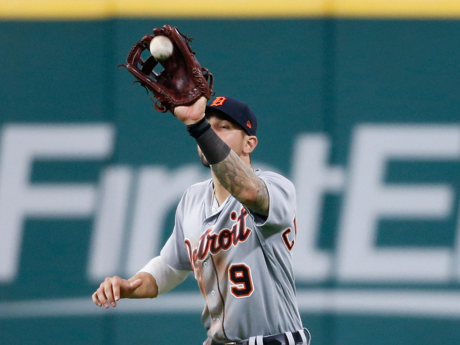 Detroit Tigers' Nicholas Castellanos makes a catch to get out Cleveland Indians' Michael Brantley during the fifth inning.
