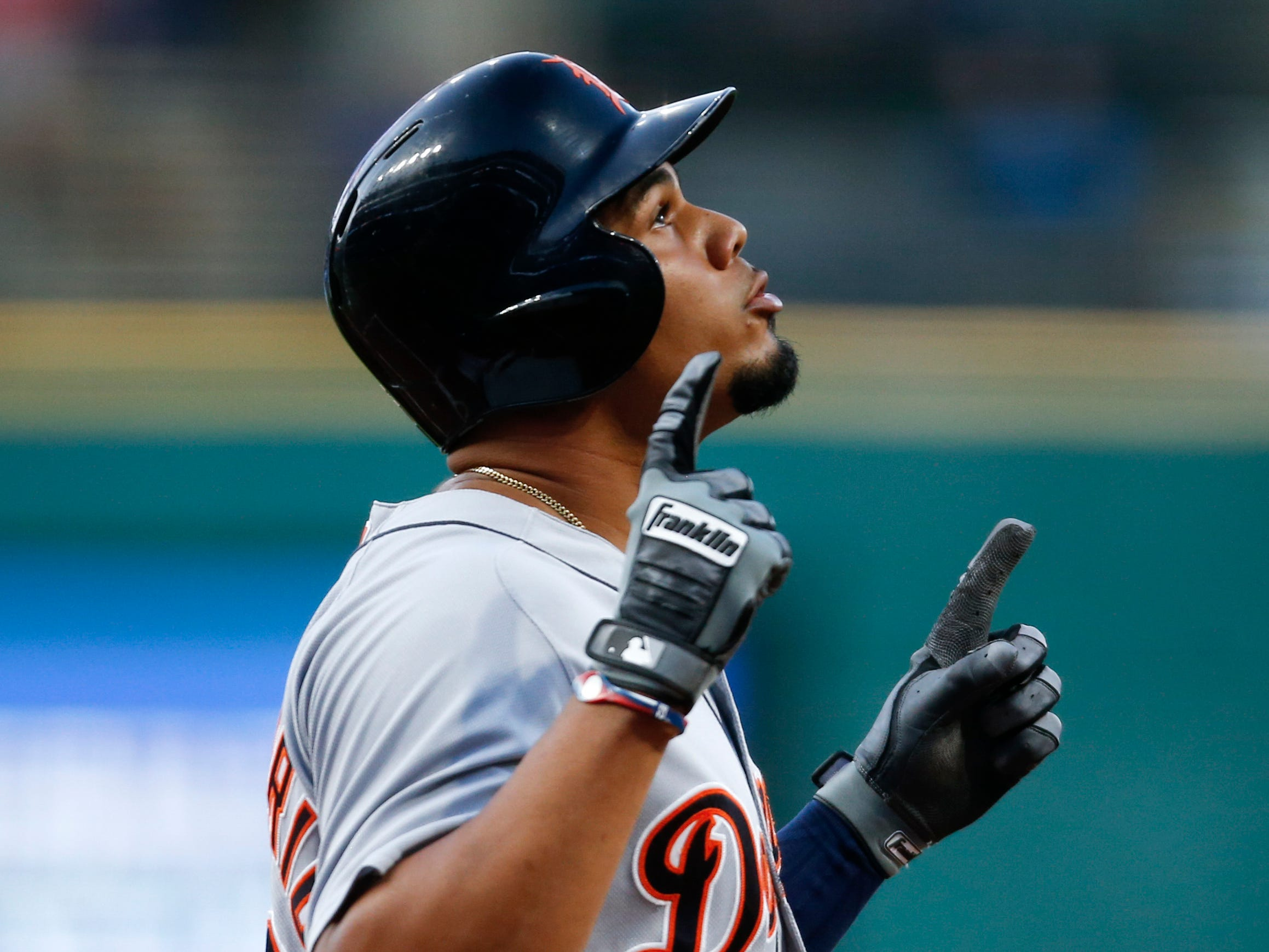 Detroit Tigers' Jeimer Candelario celebrates after hitting a solo home run off Cleveland Indians starting pitcher Josh Tomlin during the first inning of a baseball game, Friday, Sept. 14, 2018, in Cleveland.
