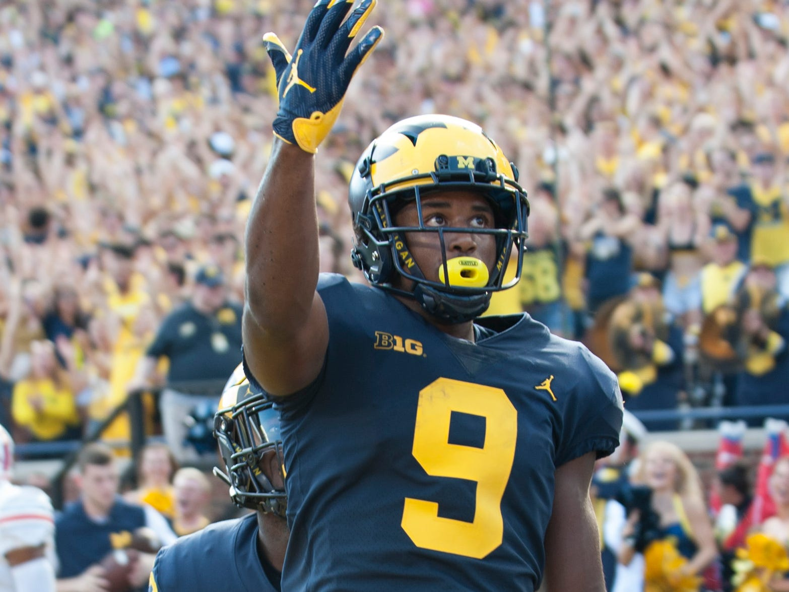 Michigan wide receiver Donovan Peoples-Jones acknowledges the Michigan crowd after scoring on a 35-yard touchdown pass from quarterback Shea Patterson in the second quarter.