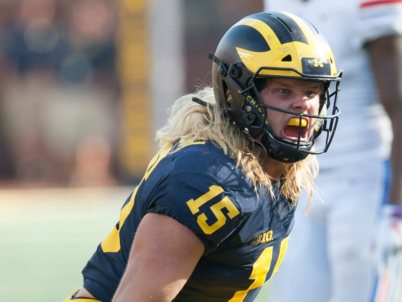 Michigan defensive lineman Chase Winovich celebrates a tackle-for-loss in the second quarter.