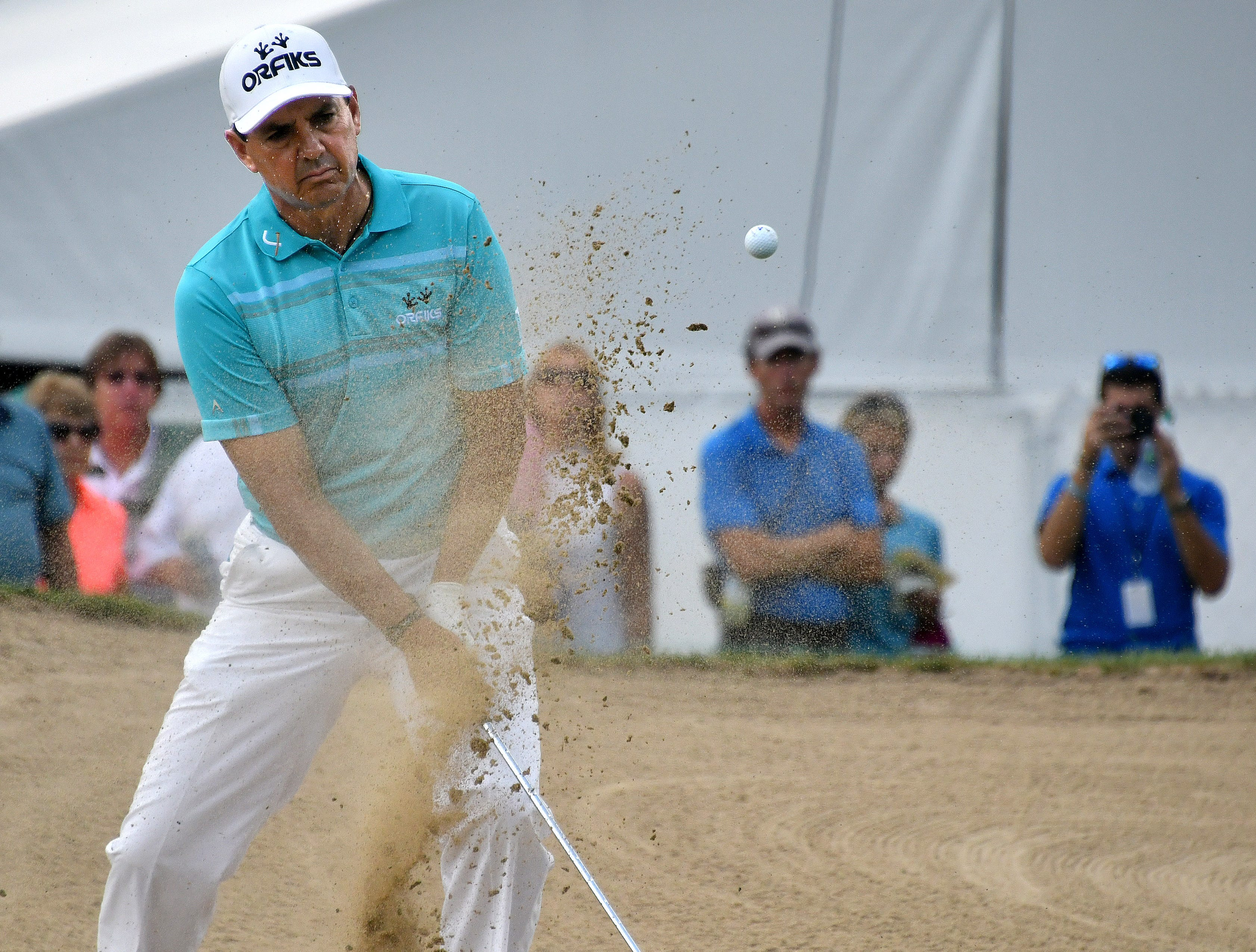 Tom Pernice hits out of the sand on the ninth hole on day one of the Ally Challenge.