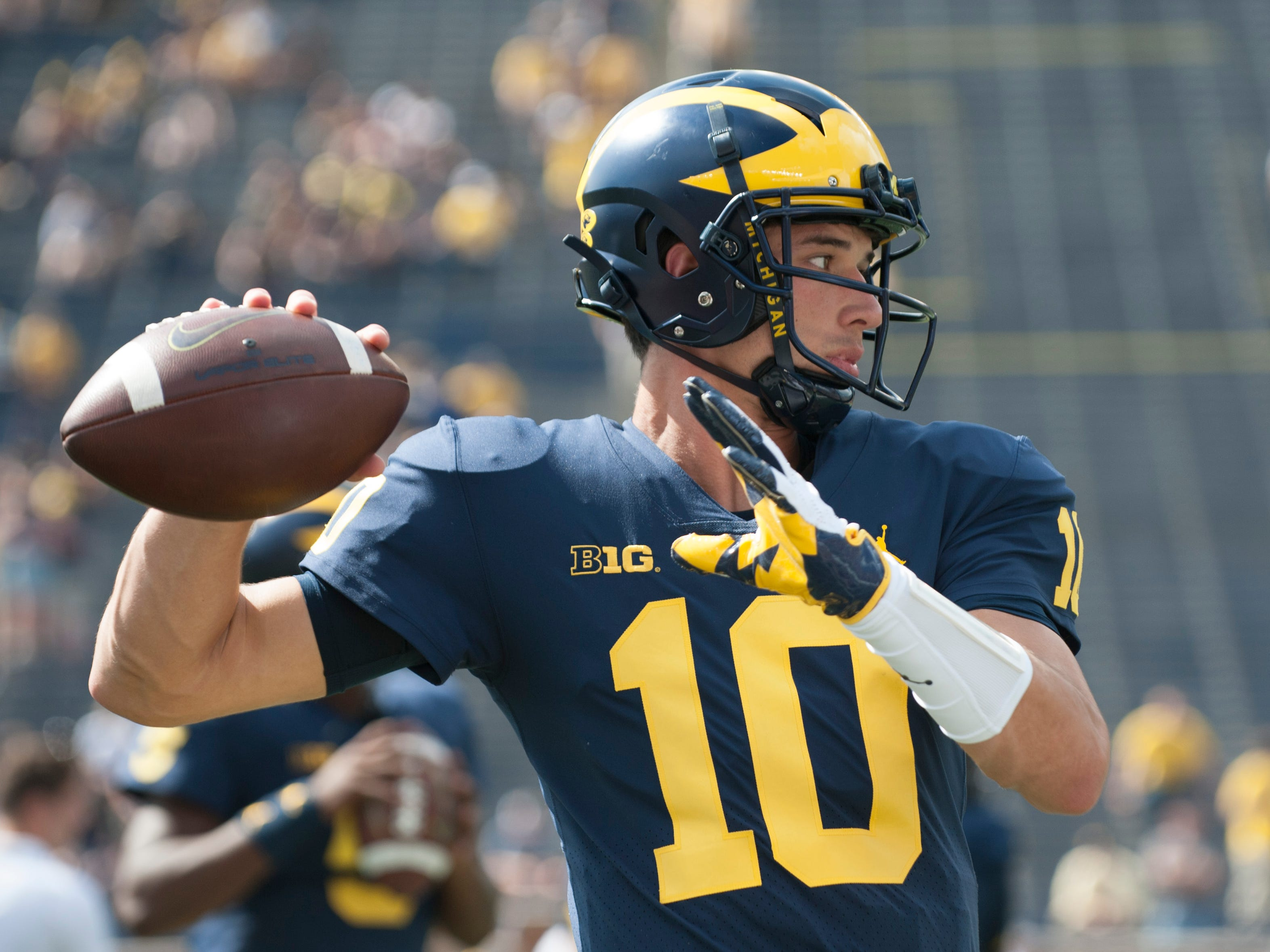 Michigan quarterback Dylan McCaffrey warms up before the game.