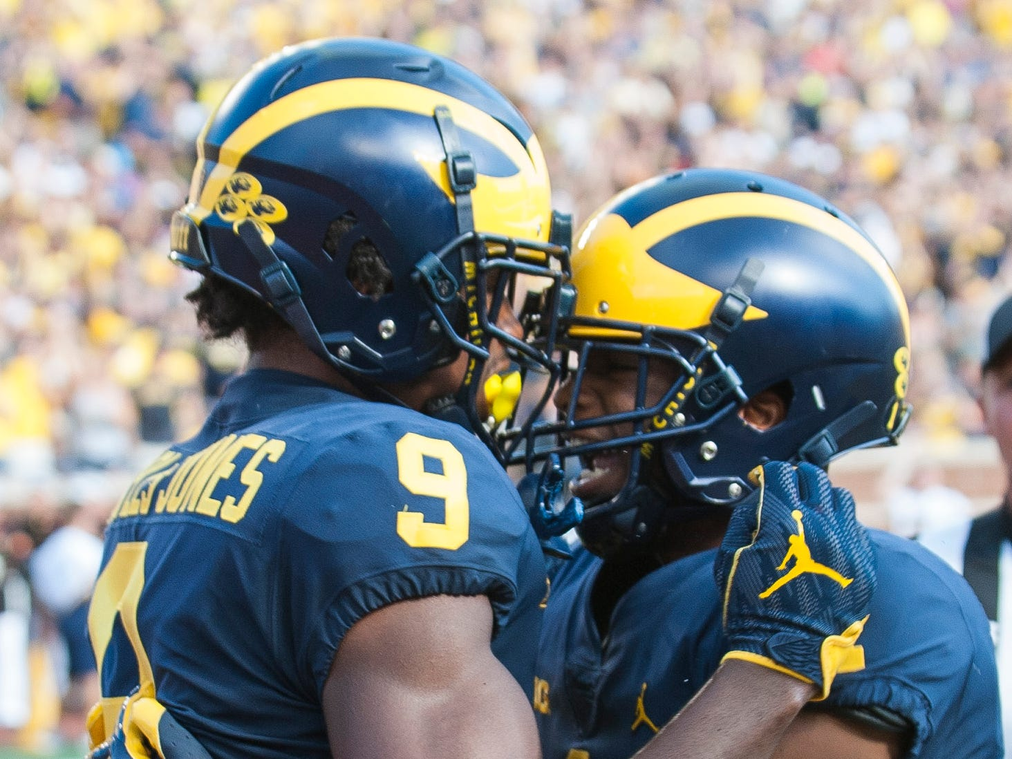 Michigan wide receiver Donovan Peoples-Jones (left) is congratulated by Ambry Thomas  after scoring on a 35-yard touchdown pass from quarterback Shea Patterson in the second quarter.