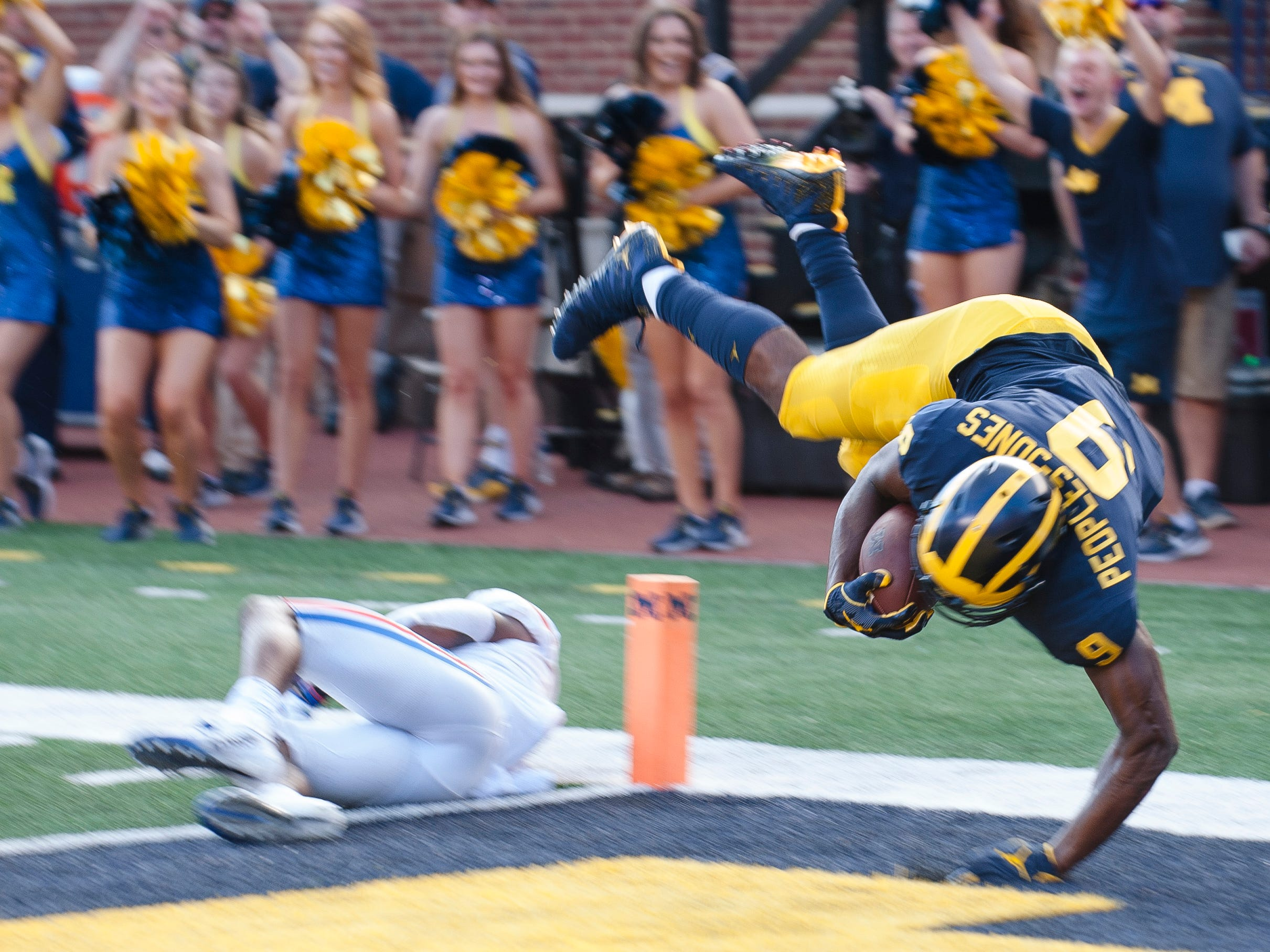 Michigan wide receiver Donovan Peoples-Jones dives over Southern Methodist cornerback Robert Hayes Jr. to score on a 35-yard touchdown pass from quarterback Shea Patterson in the second quarter.