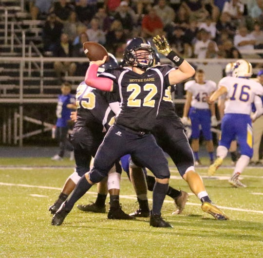 Erik Charnetski throws a pass for Elmira Notre Dame in a 42-28 loss to Lansing in eight-man football Sept. 14, 2018 at Notre Dame's Brewer Memorial Stadium.