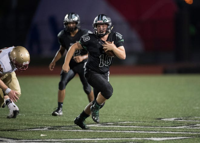 North's Quarterback A.J. Wheeler (10) carries the ball during the North vs Mater Dei game at Bundrant Stadium on Friday, Sept. 14, 2018.