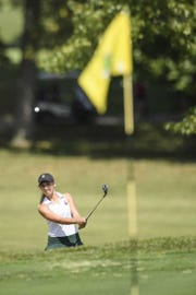 North junior Abby Whittington knocks an approach shot onto the green during the sectional at Eagle Valley Golf Course.