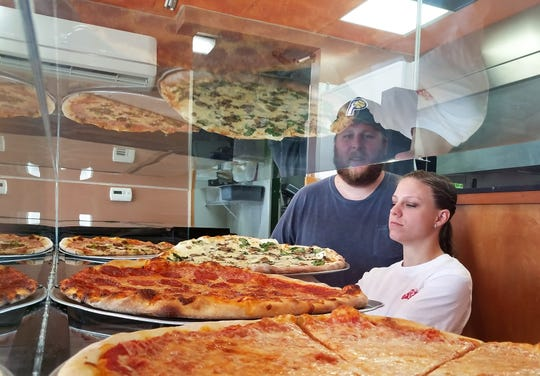 Ryan Herbertz and Misty Moench are the new owners of Lombardi's New York Pizza and Wings.