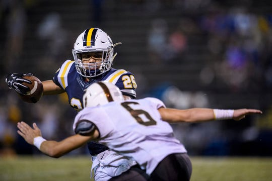 Central's Camdyn Counts (6) prepares to tackle Castle's Noah Taylor (25) during the fourth quarter at John Lidy Field in Newburgh, Ind., Friday, Sept. 14, 2018. The Bears remain undefeated – with a 5-0 record – after defeating the Knights, 41-34.