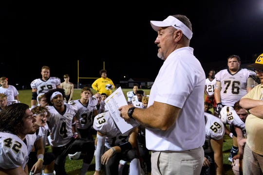 Central Head Coach Troy Burgess talks to his team about their victory over Castle on Sept. 14, 2018. Burgess left Central earlier this month to become the coach and athletics director at Frontier.