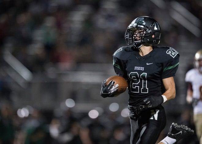 North's Dylan Mckinney (21) carries the ball in for a touchdown during the North vs Mater Dei game at Bundrant Stadium on Friday, Sept. 14, 2018.